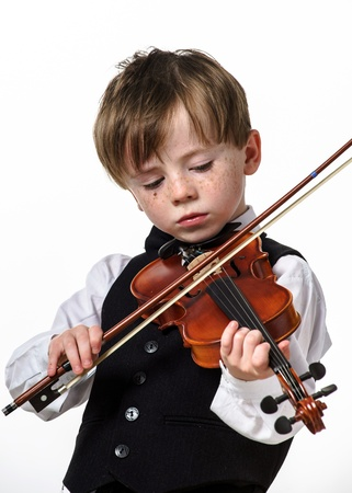 jazzbow: Freckled red-hair boy playing violin. Isolated on white background.