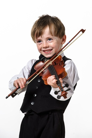 flecks: Freckled red-hair boy playing violin. Isolated on white background.