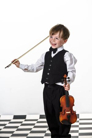 Freckled red-hair boy playing violin. Isolated on white background. photo