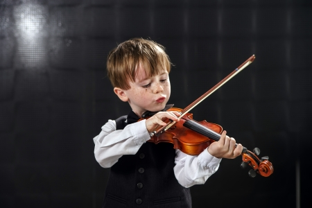 freckled: Freckled red-hair boy playing violin. Young musician.