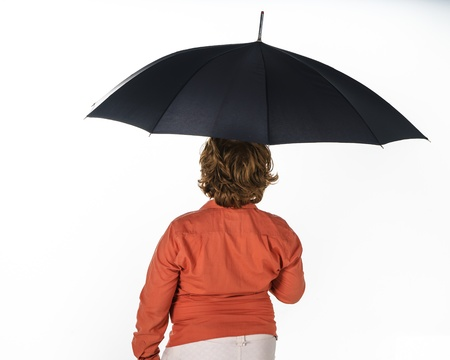 carroty: Freckled red-hair boy with umbrella. Isolated on white background.