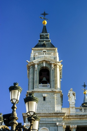 ritzy: Elegant cathedral on blue sky background in Madrid Spain