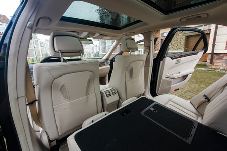Ivory color luxury town car passengers interior. photo