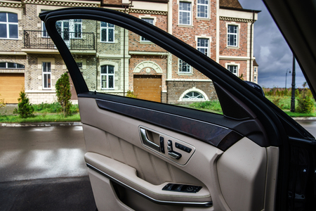 Adjustment handles in town car. Ivory luxury interior photo