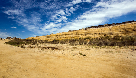ochre: Yellow ochre sand hills in Santa Cruz Portugal