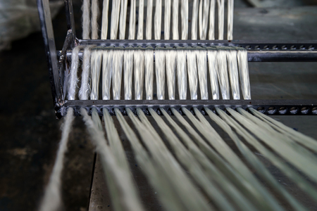 Glass roving fibre for pultrusion technology equipment. Stock Photo