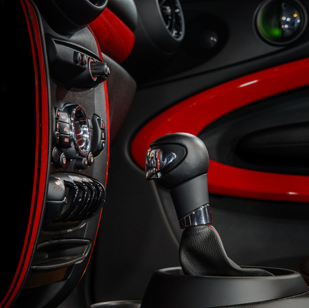 gear handle: Gear shift handle in modern sport car. Red and black. Stock Photo