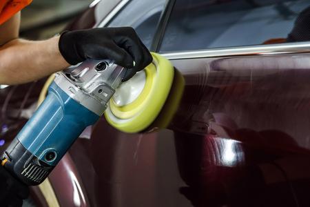 Car surface buffing. Renewing using polish machine.