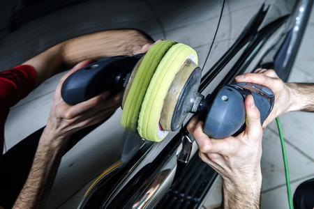 coating: Car surface buffing. Renewing using polish machine.