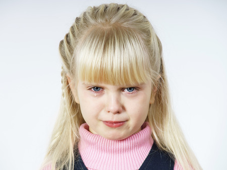 Cute little towhead girl portrait isolated on white background photo