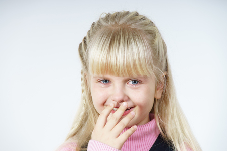 Cute little towhead girl portrait isolated on white  photo