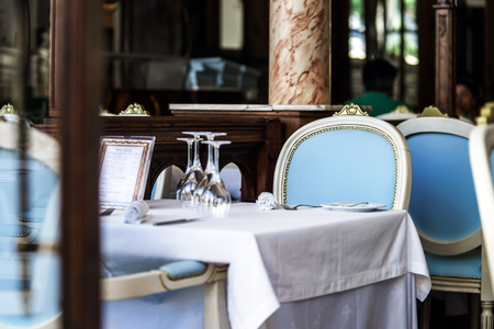 Old-styled restaurant waiting for visitors. Served tables. Stock Photo - 23989754