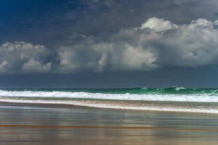 wheather: Green ocean waves in stormy wheather. Portugal coast. Stock Photo