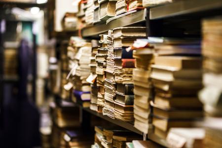 Stacks with many old books in antique shop Reklamní fotografie - 23990004