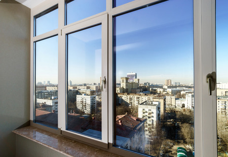 View to the city through new glass windows Standard-Bild
