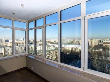balcony window: View to the city through new glass windows Stock Photo