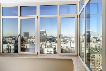View to the city through new glass windows Stock Photo
