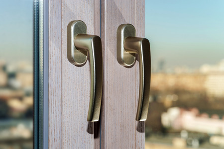 Gold window handles on new glass frame
