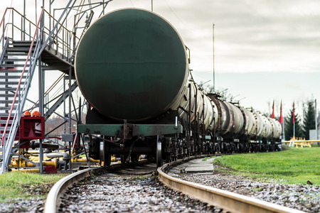 Train with oil tanks in a refinery photo