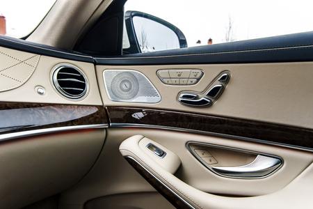 Luxury car interior details. Skin and chromium.