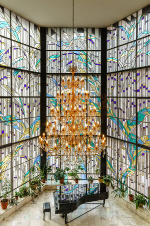 electrolier: Crystal chandelier and leaded pane in music school hall