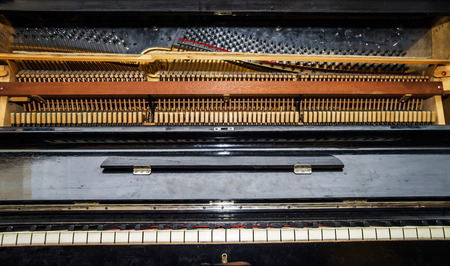 classical mechanics: Inside view of old vintage piano. Musical instrument. Stock Photo