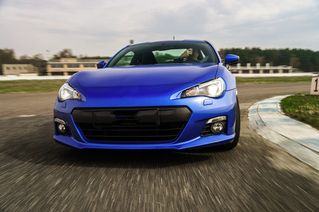 sports car: Blue sport car on race way. Motion capture. Stock Photo