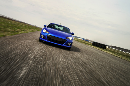 car race: Blue sport car on race way. Motion capture. Stock Photo