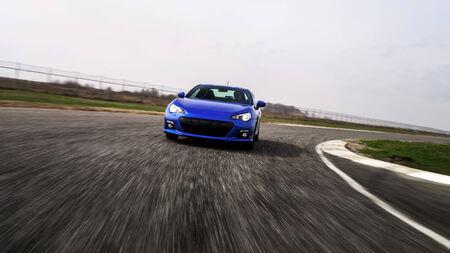 Blue sport car on race way. Motion capture. Standard-Bild