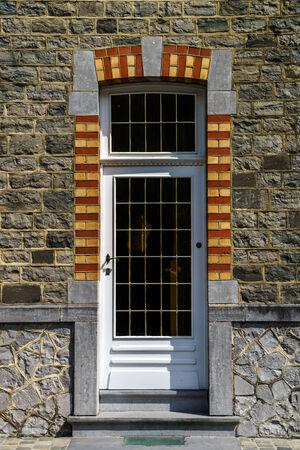 belgique: Simple decoration of entrance wooden door in small village Stock Photo