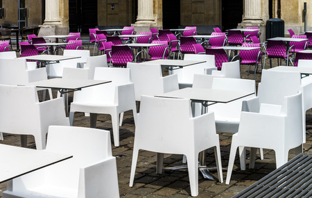 White and violet chairs and tables in street cafe photo
