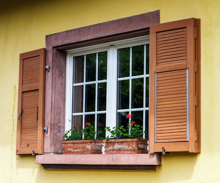 Renovated pvc windows in old village house, Alsace, France Stock Photo - 28530912