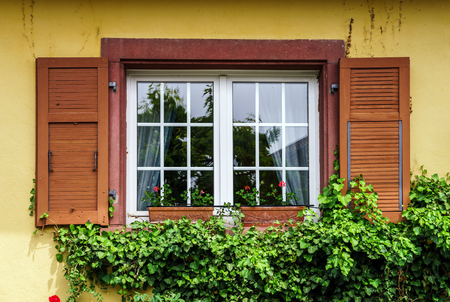 Renovated pvc windows in old village house, Alsace, France Stock Photo - 28530902
