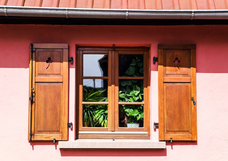 Renovated pvc windows in old village house, Alsace, France Stock Photo - 28530931