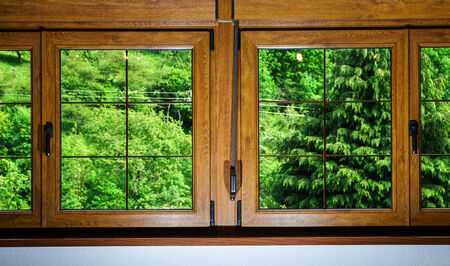 Laminated PVC windows in villagr house, inside view. photo