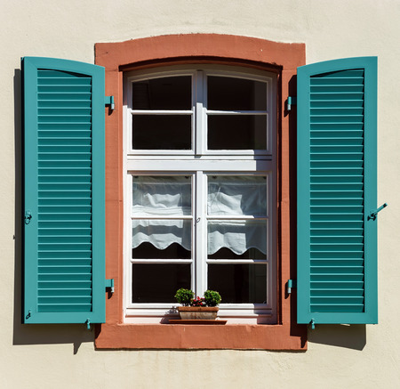 Renovated pvc wwindows in old village house, France Stock Photo - 28711515
