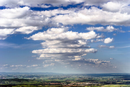 Big cumulus clouds over the land of Alsace, France