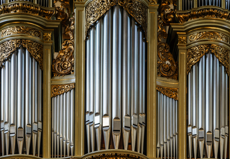 pipe organ: Beautiful old organ decorated by gold in the village church