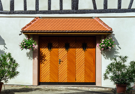 Renovated wooden garage doors in old house, Alsace, France Stock Photo - 29171223