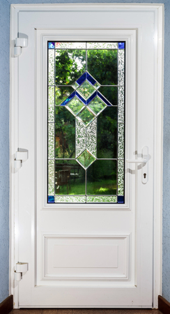 Entrance pvc door with tiffany leaded pane for villagee house photo