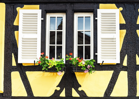 Renovated windows with shutters in village timber-frame house Stock Photo - 29269820