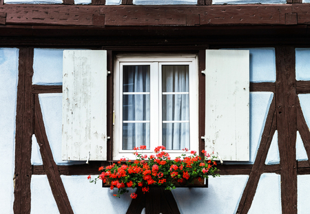 Renovated windows with shutters in village timber-frame house Stock Photo - 29269823