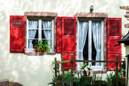 Renovated windows with shutters in village timber-frame house Stock Photo - 29269081