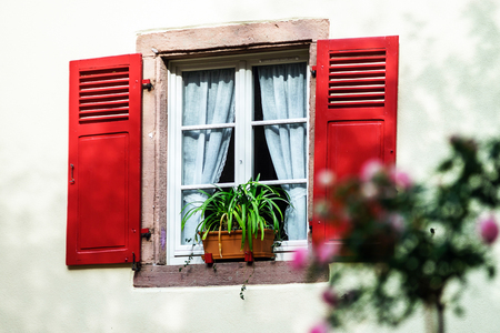 Renovated windows with shutters in village timber-frame house Stock Photo - 29269082
