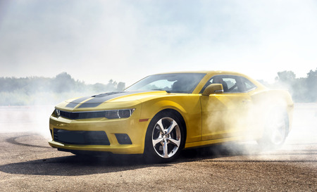fire car: Luxury yellow sport car drifting, motion capture Stock Photo