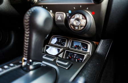 lux: Luxury car interior details. Transmission handle, skin. Stock Photo