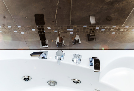 New bathroom fitment, modern style interior, apartments photo