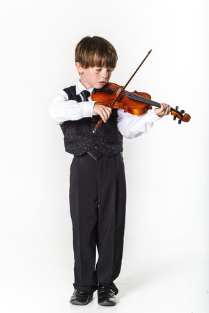 jazzbow: Red-haired preschooler boy with violin, music education