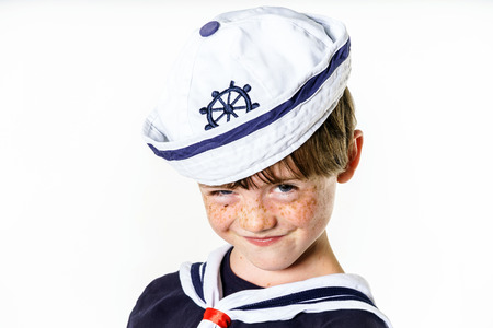 Cute little carroty boy dressed in sailor suit