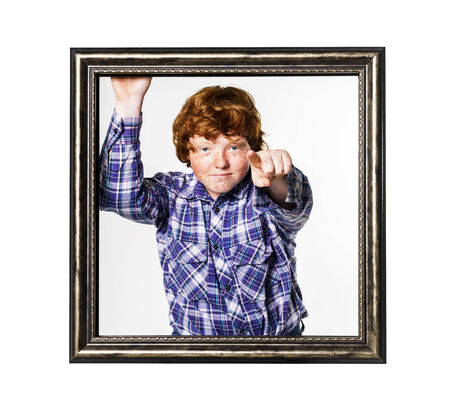 laughable: Emotional red-haired boy posing with picture frame isolated on white Stock Photo